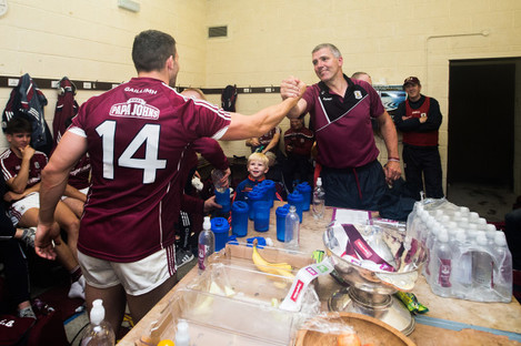Damien Comer celebrates with manager Kevin Walsh the changing room