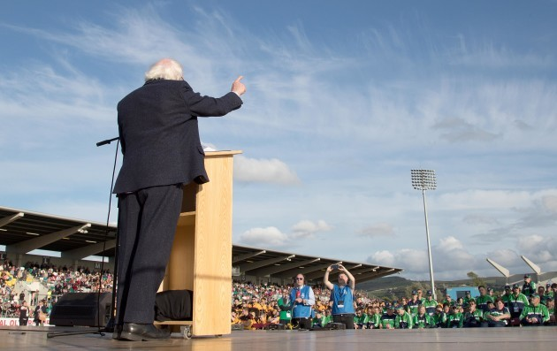 Michael D. Higgins speaks on stage to the athletes