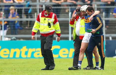 Brendan Maher leaves the field injured