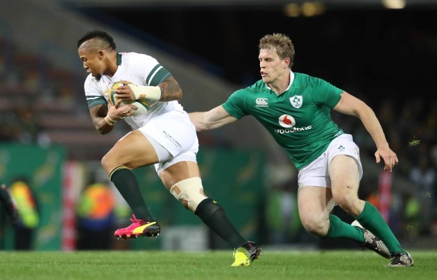 Springboks Elton Jantjies chased by Ireland's Andrew Trimble