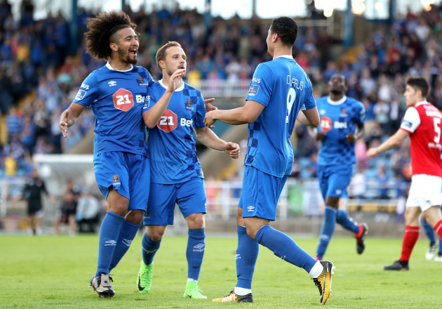 Courtney Duffus celebrates scoring a goal with Bastien Hery and Sander Puri