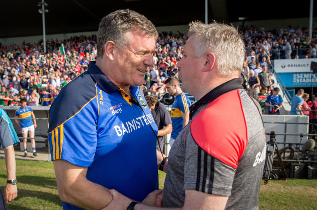 Stephen Rochford shakes hands with Liam Kearns after the game