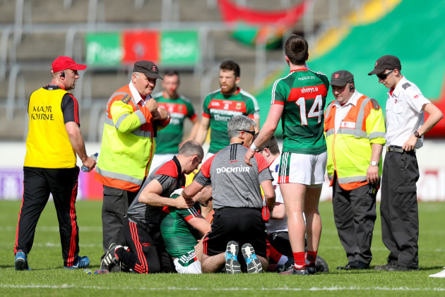 Seamus O'Shea receives medical attention