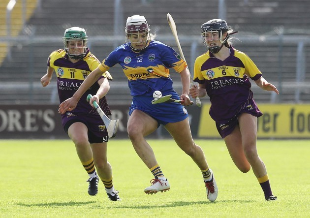 Stacey Kehoe and Ciara O'Connor tackle Orla O'Dwyer