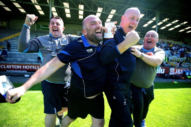 Tom McGlinchey and his back room team celebrate at the final whistle