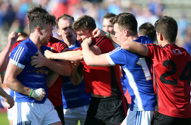 Down and Cavan players tussle after the game
