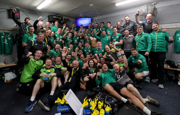 Ireland players and staff celebrate in the dressing room after the game