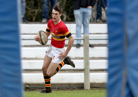 Eoghan Barrett on his way to scoring a try