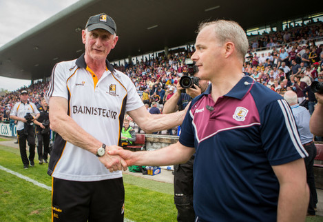 Micheál Donoghue shakes hands with Brian Cody after the game