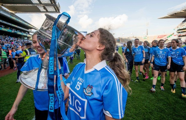 Noelle Healy kisses the Brendan Martin Cup