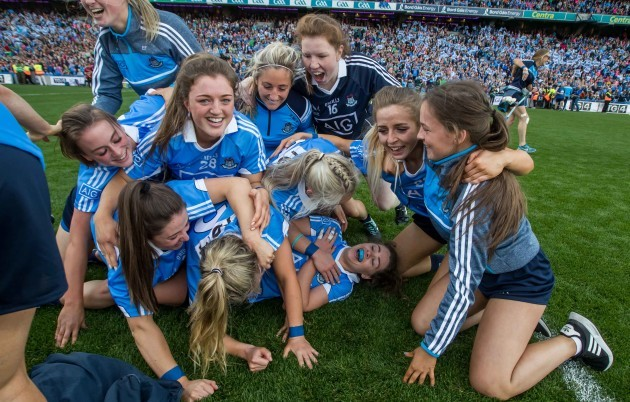 Dublin players celebrate with Noelle Healy