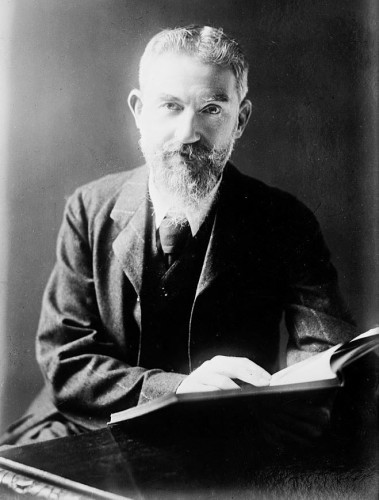 George_Bernard_Shaw_at_desk_with_book