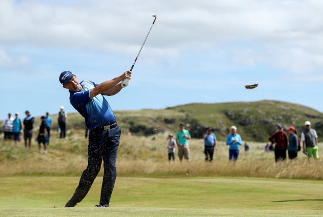 Padraig Harrington hits his approach to the eighth green