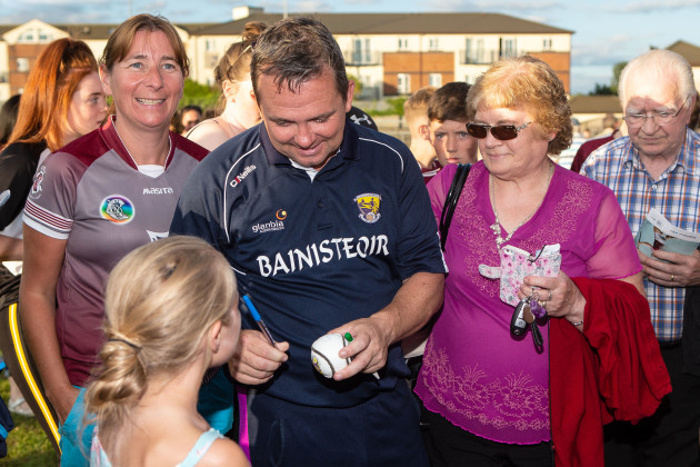 Davy Fitzgerald signs autographs after the game