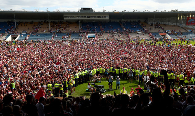 Galway fans on the field after the game