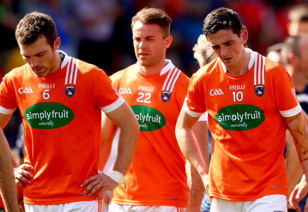 Brendan Donaghy, Kevin Dyas and Rory Grugan dejected after the game