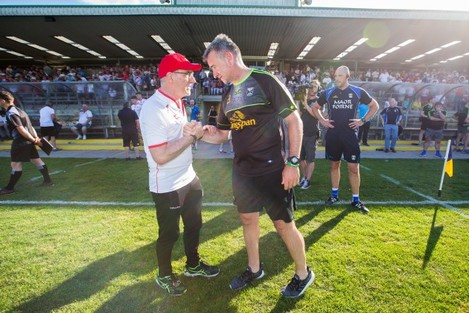 Matthew McGleenan with manager Mickey Harte after the game