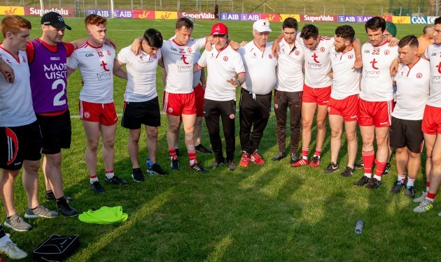 Mickey Harte talks to his team after the game