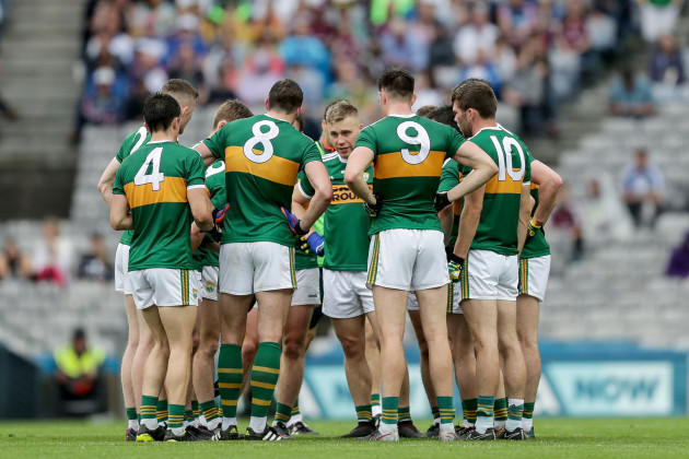 The Kerry team huddles during the game