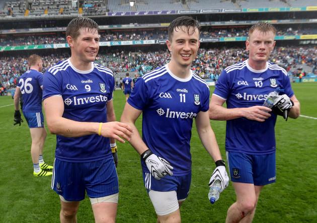 Darren Hughes, Shane Carey and Ryan McAnespie celebrate after the game
