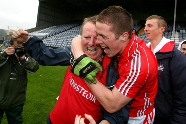 John Cleary celebrates with captain Colm O'Neill
