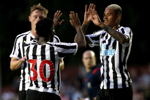 Christian Atsu celebrates scoring a goal with Kenedy