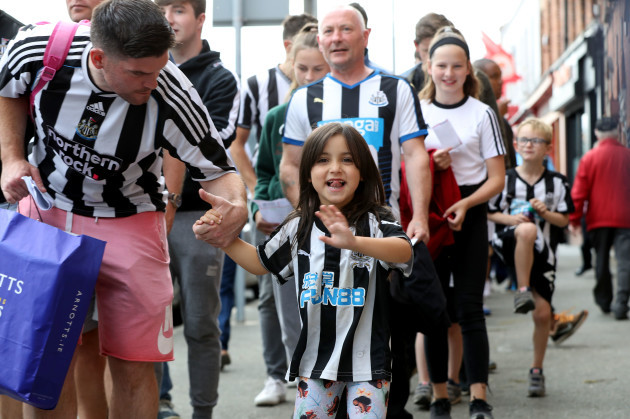A young Newcastle United fan arriving at Richmond Park