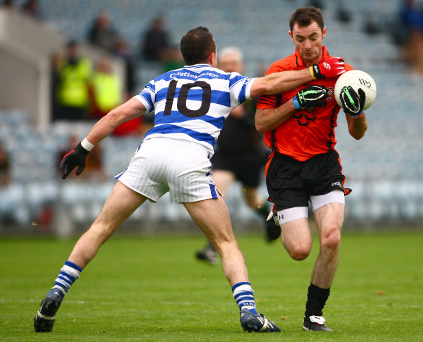 Donncha O'Connor is tackled by Roland Whelton