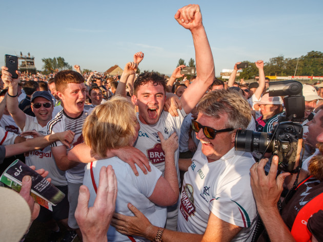 David Hyland celebrates with his mother Maire after the game