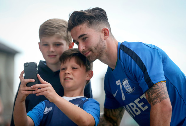 Sean Maguire takes a selfie with fans after the game
