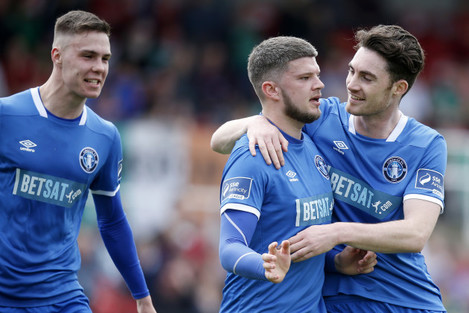 Danny Morrissey celebrates scoring a goal with Cian Coleman and Eoin Wearen