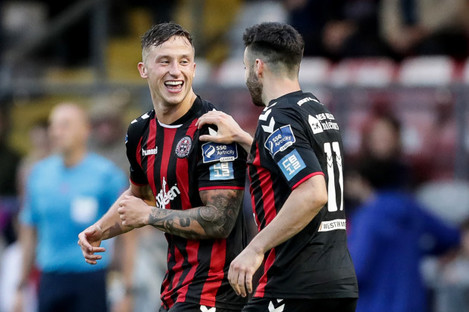 Rob Cornwall celebrates scoring a goal with Kevin Devaney