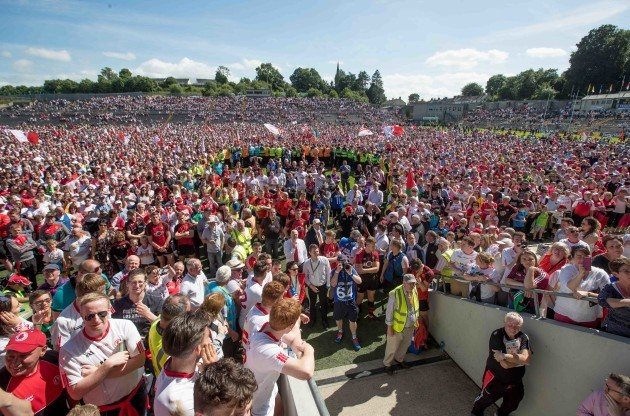 Tyrone supporters on the pitch after the game