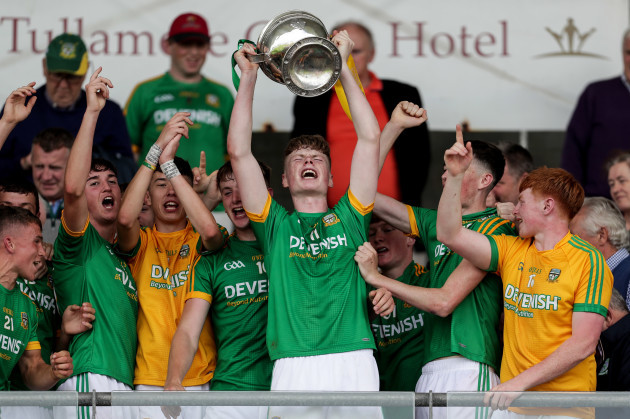 Meath players celebrate with the trophy