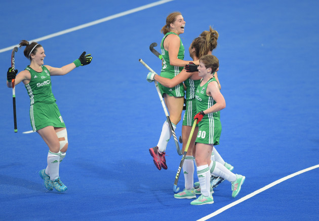 celebrates her second goal with team mates