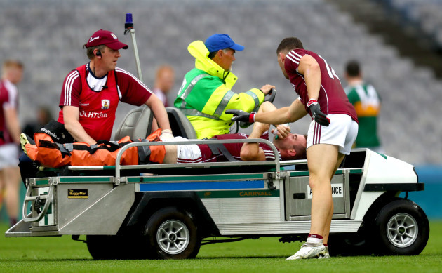 Damien Comer checks on the injured Paul Conroy