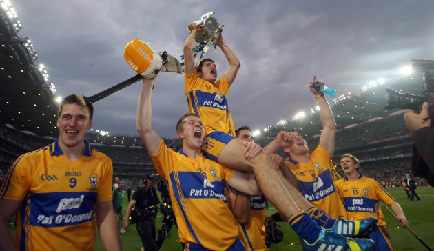 Shane O'Donnell holds the Liam McCarthy Cup while being lifted in front of Hill 16 by team mates