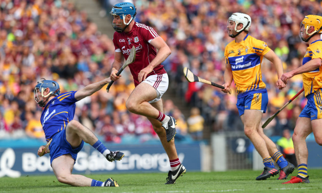 Conor Cooney scores past goalkeeper Donal Tuohy