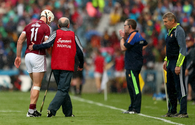 Joe Canning leaves the field the injured