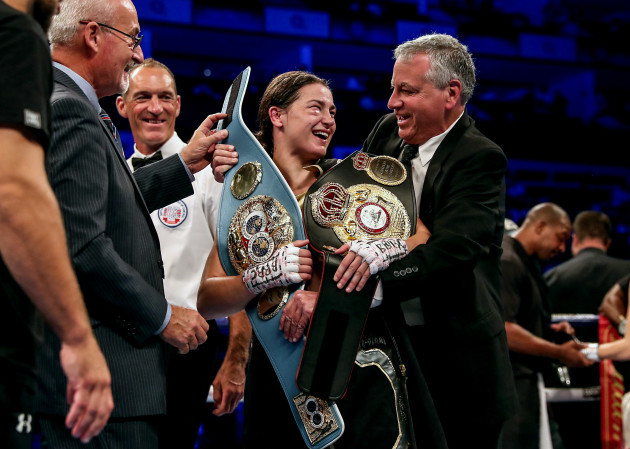 Katie Taylor receives her WBA and IBF belts