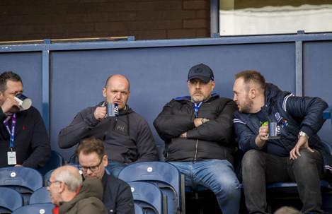 Matt Taylor, Gregor Townsend, Dan McFarland and Gavin Vaughn take in the game