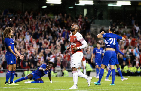 Alexandre Lacazette celebrates scoring a late goal