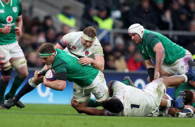 Ireland's  CJ Stander is tackled by England's Dylan Hartley and Mako Vunipola