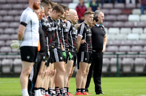 Cathal Corey stands with his team during the national anthem