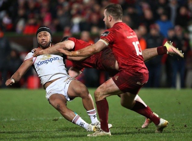 Christian Lealiifano receives a high tackle from  Sammy Arnold