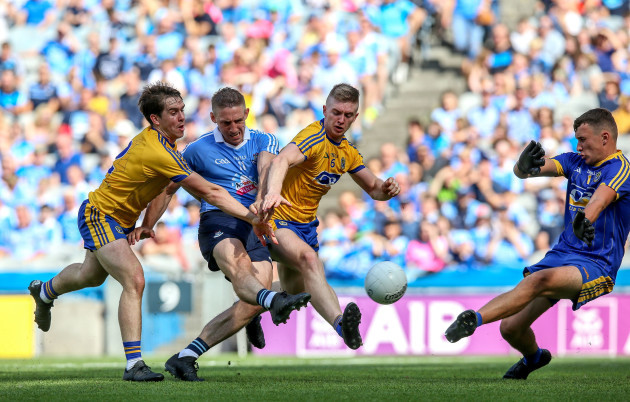 Eoghan O'Gara scores a goal under pressure from David Murray and Darra Pettit