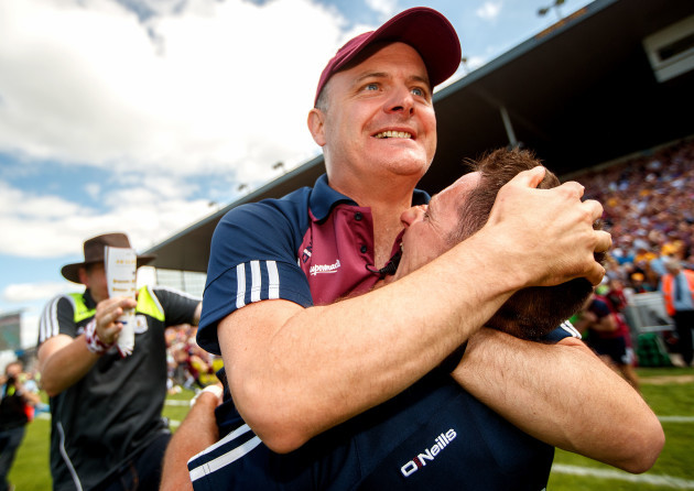 Michael Donoghue celebrates with selector Noel Larkin after the game