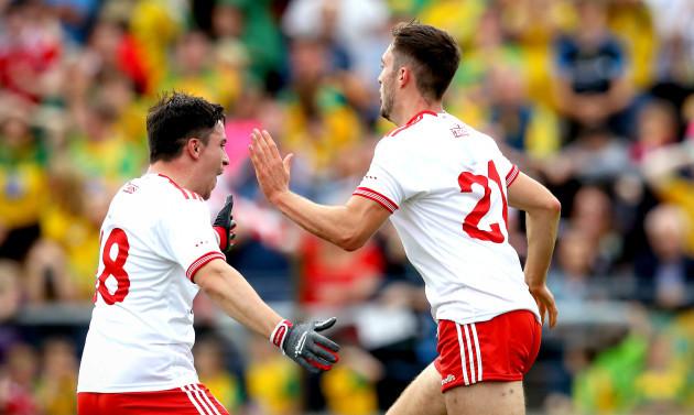 Harry Loughran celebrates scoring a goal with Lee Brennan