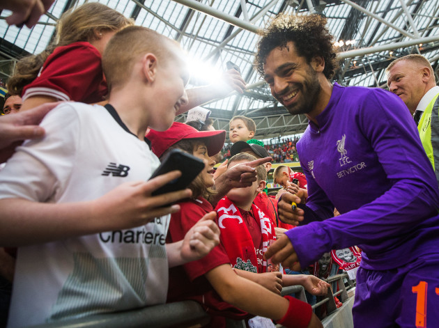 Mohamed Salah signs autographs after the game