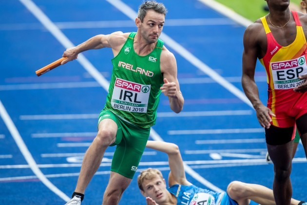 Thomas Barr is forced to jump a fellow athlete as he takes the baton from Leon Reid
